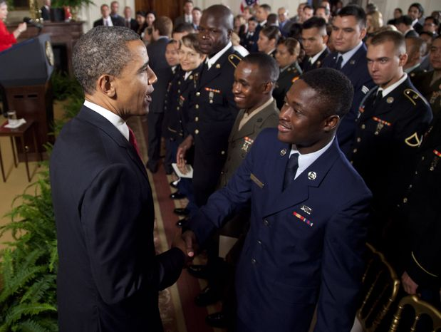 President Obama greets service members July 4, 2012, after they became U.S. citizens during a naturalization ceremony at the White House. (Associated Press)
