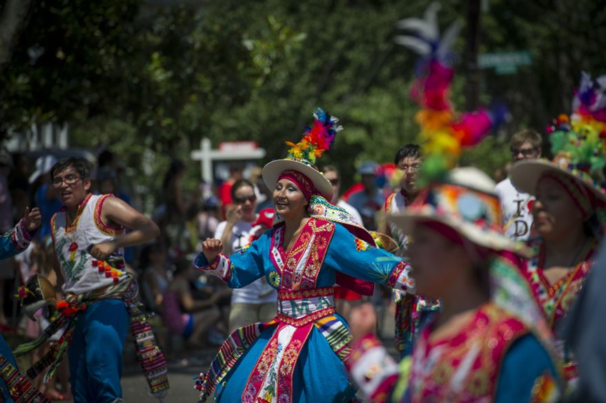 The group Alma Boliviana dances in the street as they take part in the 46th Annual Palisades Parade and Picnic. (Rod Lamkey Jr./The Washington Times)
