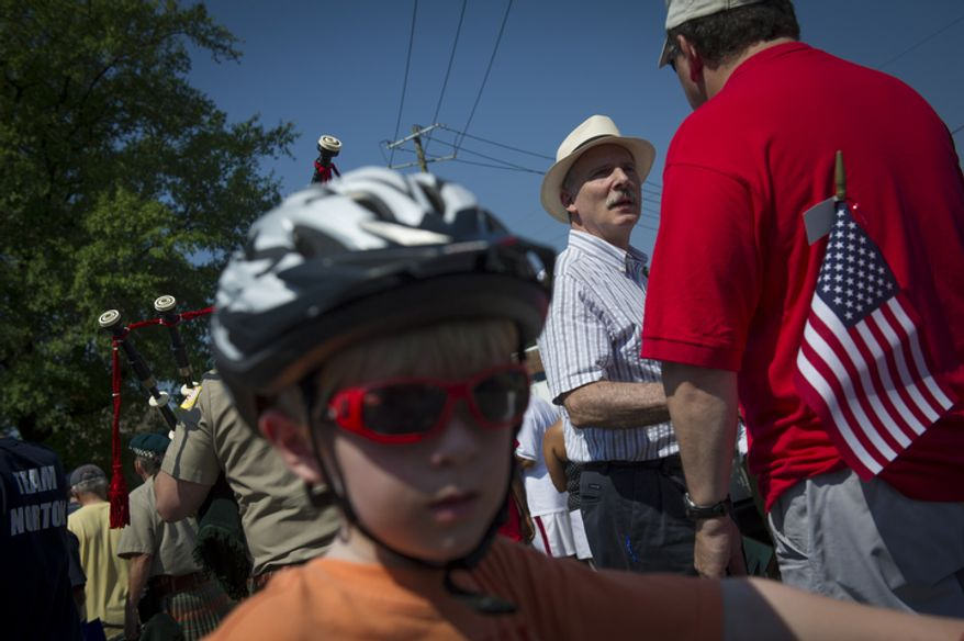 Interim D.C. Council Chair Phil Mendelson (center) greets people in the crowd before walking in the 46th Annual Palisades Parade and Picnic. (Rod Lamkey Jr./The Washington Times)