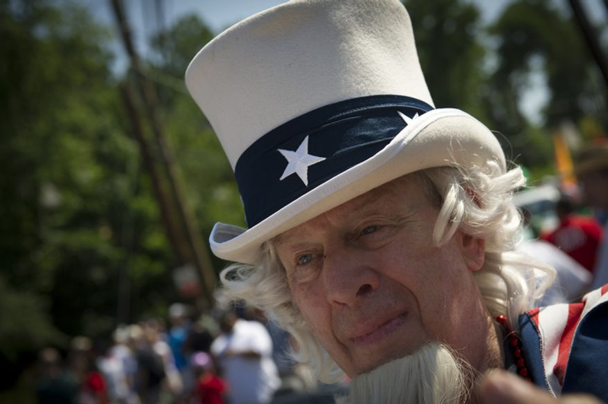 Grant Berning, of Dunn Loring, Va., plays the part of Uncle Sam in the 46th Annual Palisades Parade and Picnic. (Rod Lamkey Jr./The Washington Times)