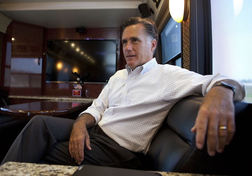 **FILE** Republican presidential candidate Mitt Romney talks June 8, 2012, with his staff while riding on his bus after a campaign stop in Council Bluffs, Iowa. (Associated Press)