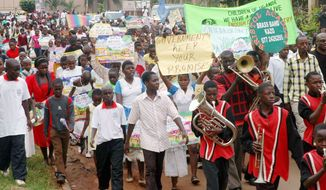Thousands of youths demonstrate against homosexuality in Uganda's capital, Kampala, in January 2010. Ugandan Ethics and Integrity Minister Simon Lokodo has accused some nongovernmental organizations of conspiring with foreign backers to recruit children into homosexuality. (Associated Press)