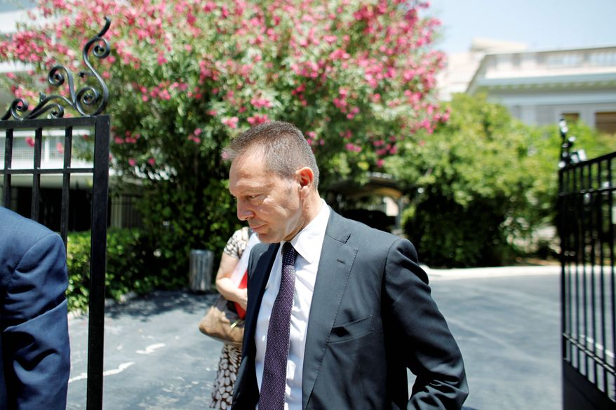 Greece's new finance minister, Yannis Stournaras, leaves Thursday after meeting in Athens with Prime Minister Antonis Samaras and debt inspectors from the European Central Bank, European Commission and International Monetary Fund. (Associated Press)