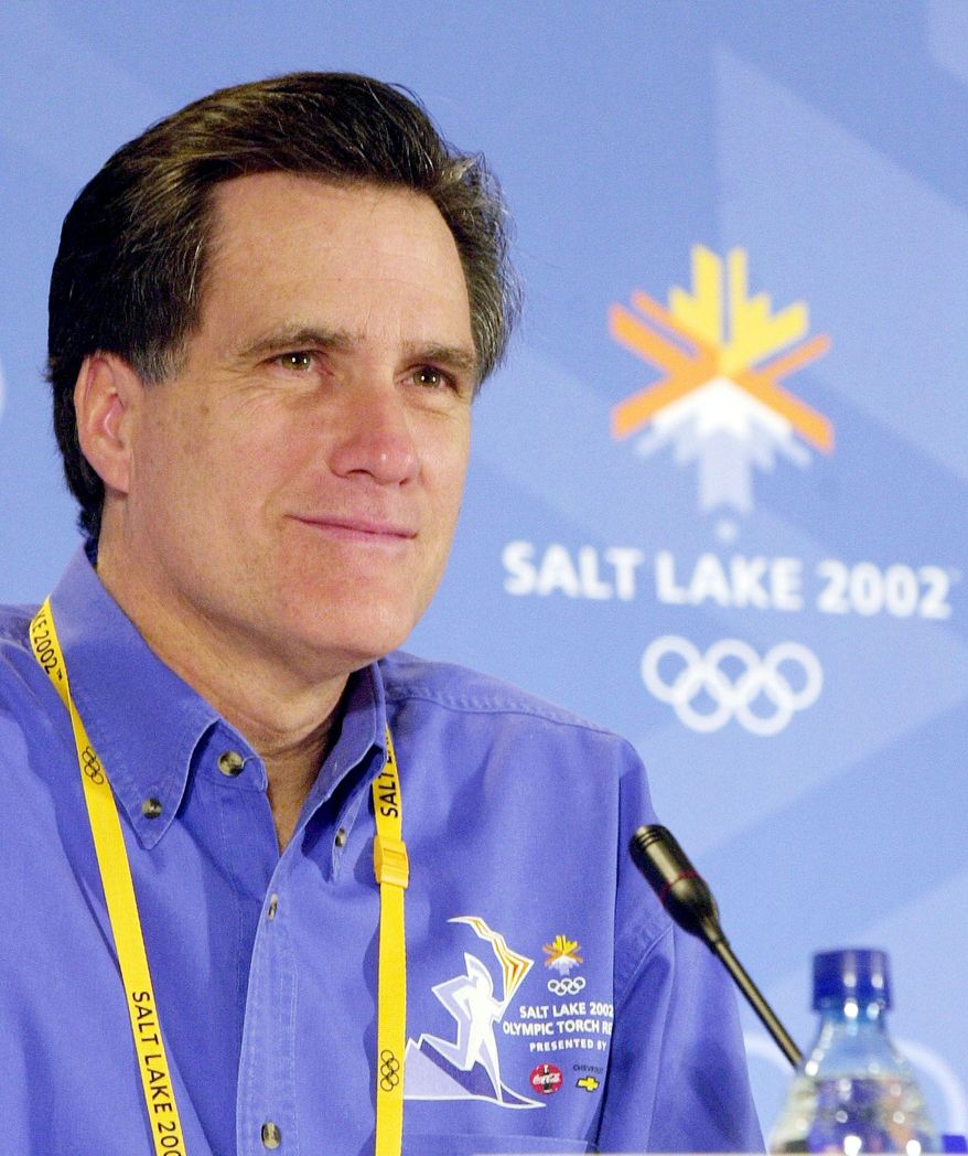 Mitt Romney, seen here in February 2002 as president of the Salt Lake Organizing Committee, will attend this year's London Olympics. (Associated Press)