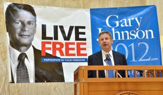 **FILE** Former New Mexico Gov. Gary Johnson announces his bid for the Libertarian Party presidential nomination on Dec. 28, 2011, in the rotunda of the New Mexico State Capitol in Santa Fe, N.M. (Associated Press/The New Mexican)
