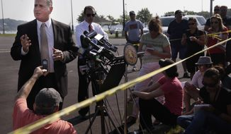 Detective Lt. John Azzata (left) of the Nassau County Police Department gives information about a fatal boating accident during a news conference in Oyster Bay, N.Y., on Thursday, July 5, 2012. (AP Photo/Seth Wenig)