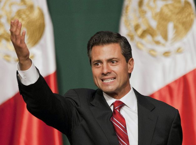 ** FILE ** Presidential candidate Enrique Pena Nieto waves to supporters at his party's headquarters in Mexico City early on Monday, July 2, 2012. Mexico's old guard sailed back into power after a 12-year hiatus Sunday as the official preliminary vote count handed a victory to Mr. Pena Nieto, whose party long was accused of ruling the country through corruption and patronage. (AP Photo/Christian Palma)