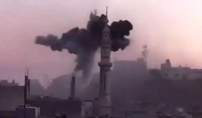 In this image made from amateur video released by the Ugarit News and accessed Monday, July 2, 2012, black smoke leaps the air from shelling near Ali bin Abi Taleb mosque in Talbiseh, the central province of Homs, Syria. The Associated Press cannot independently verify the content, date, location or authenticity of this material. (AP Photo/Ugarit News via AP video)