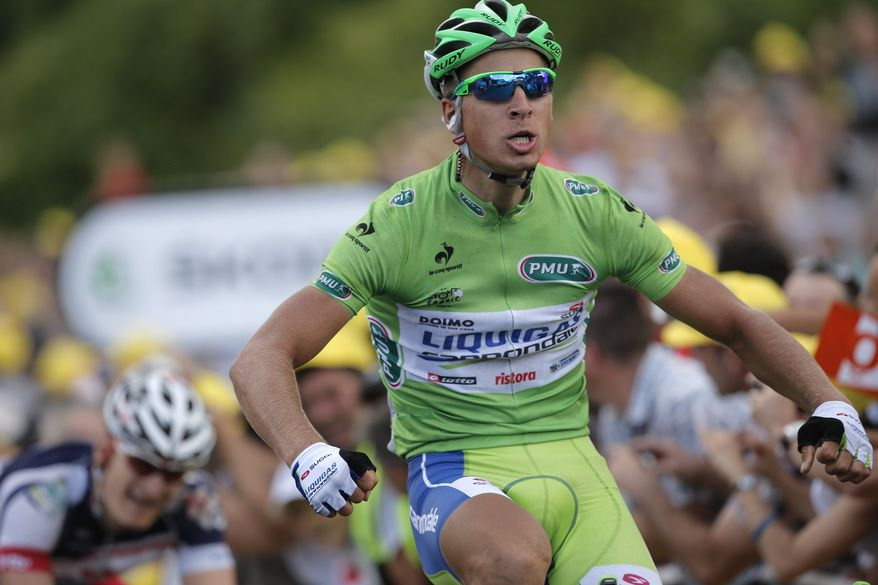Peter Sagan of Slovakia, wearing the best sprinter's green jersey, crosses the finish line ahead of Andre Greipel of Germany, bottom left, to win the sixth stage of the Tour de France cycling race over 207.5 kilometers (129 miles) with start in Epernay and finish in Metz, France, Friday July 6, 2012. (AP Photo/Christophe Ena)