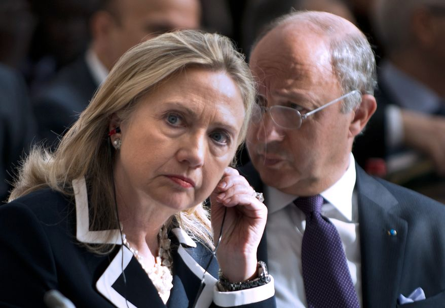 """U.S. Secretary of State Hillary Rodham Clinton and French Foreign Minister Laurent Fabius attend the """"Friends of Syria"""" conference in Paris on July 6, 2012. (Associated Press)"""
