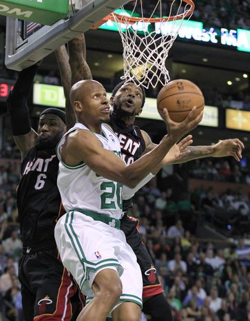 File - In this June 1, 2012, file photo, Boston Celtics guard Ray Allen (20) drives past Miami Heat forward LeBron James (6) and forward Udonis Haslem during the second quarter of Game 3 in the NBA basketball playoffs Eastern Conference finals in Boston. Allen told the Miami Heat on Friday night, July 6, 2012, that he has decided to leave the Celtics and join up with the reigning NBA champions. (AP Photo/Elise Amendola, File)