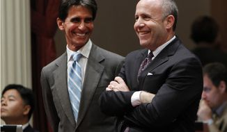 Senate Mark Leno, D-San Francisco, left, and Senate President Pro Tem Darrell Steinberg, right, smile as the vote is taken for a bill authorizing about $4.5 billion in funding for a high-speed rail system, at the Capitol in Sacramento, Calif., Friday, July 6, 2012. The bill, which would allow the state to begin selling $2.6 billion in voter-approved bonds, was approved by a 21-16 vote and now goes to Gov. Jerry Brown who has supports the measure. (AP Photo/Rich Pedroncelli)