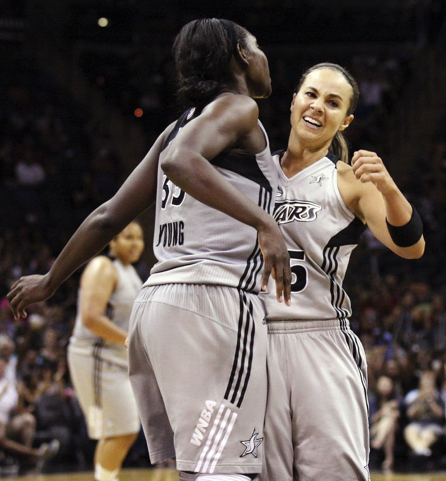 San Antonio Silver Stars' Sophia Young, left, and Becky Hammon celebrate after Young scored against the Minnesota Lynx during their WNBA basketball game in San Antonio, Sunday, July 1, 2012. (AP Photo/The San Antonio Express-News, Edward A. Ornelas)  RUMBO DE SAN ANTONIO OUT; NO SALES; MANDATORY CREDIT; MAGS OUT