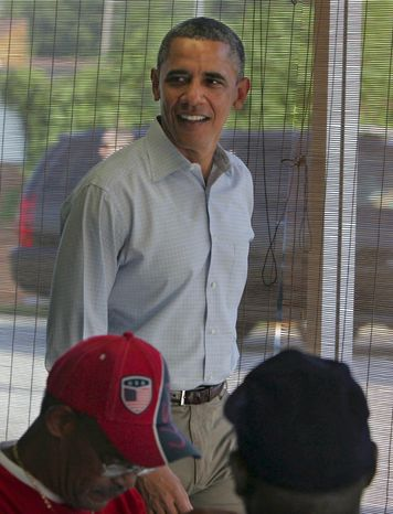 President Obama meets local residents July 6, 2012, during a stop at Ann's Place in Akron, Ohio, during a two-day campaign bus trip in Ohio and Pennsylvania. (Associated Press/Akron Beacon Journal)