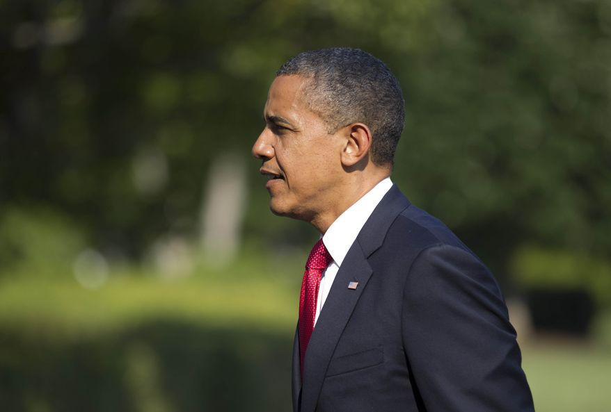 President Barack Obama arrives on the South Lawn of the White House on Friday, July 6, 2012, in Washington after campaigning for two days in Ohio and Pennsylvania. (AP Photo/Evan Vucci)