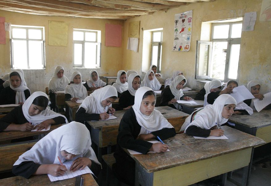In this Thursday, July 5, 2012, photo, Afghan students are seen during passing their midyear school examinations at the Mirbachakot high school on the outskirts of Kabul, Afghanistan. Afghanistan will seek at least $4 billion from international donors this weekend at a crucial aid conference aimed at propping up the country after most foreign combat troops leave at the end of 2014. (AP Photo/Musadeq Sadeq)