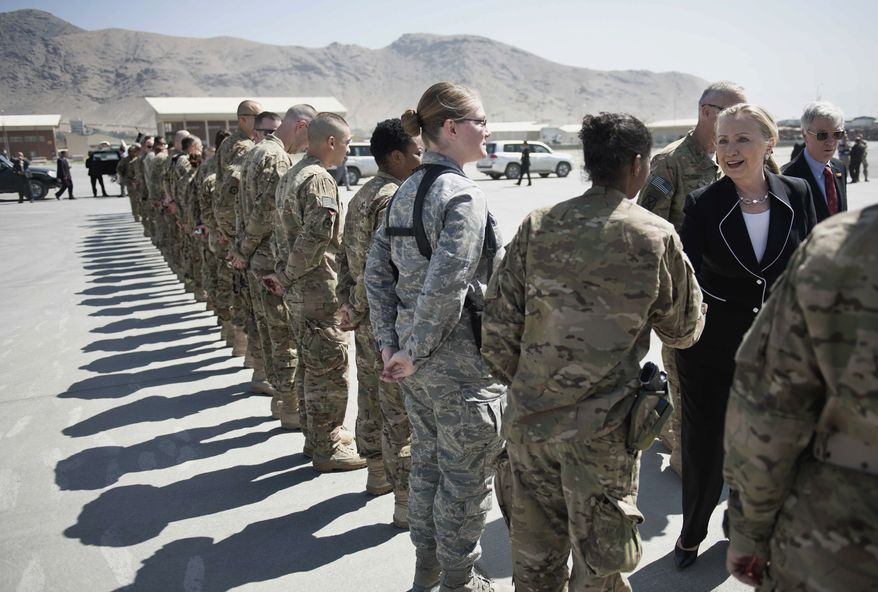 U.S. Secretary of State Hillary Rodham Clinton, right, greets troops before departing Kabul International Airport Saturday July 7, 2012. (AP Photo/Brendan Smialowski, Pool)