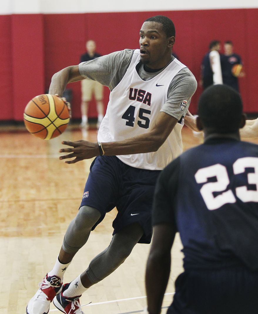 Kevin Durant (45) makes a pass as the U.S. men's national basketball team practices at the Mendenhall Center on the UNLV campus in Las Vegas on Friday, July 6, 2012. (AP Photo/Las Vegas Review-Journal, Jason Bean)
