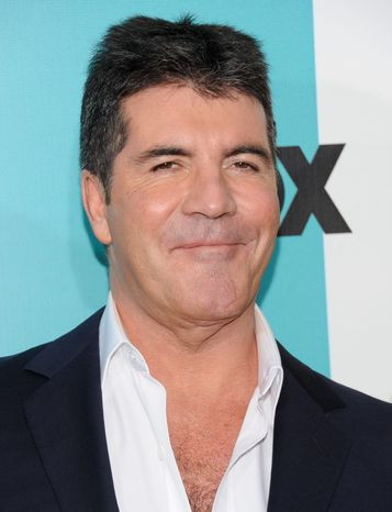 """The X Factor"" judge Simon Cowell said he was watching TV at home in March when he heard a crash and discovered a woman holding a brick in a bathroom. A plea agreement reached Friday means Leanne Zaloumis won't face a trial. (Associated Press)"
