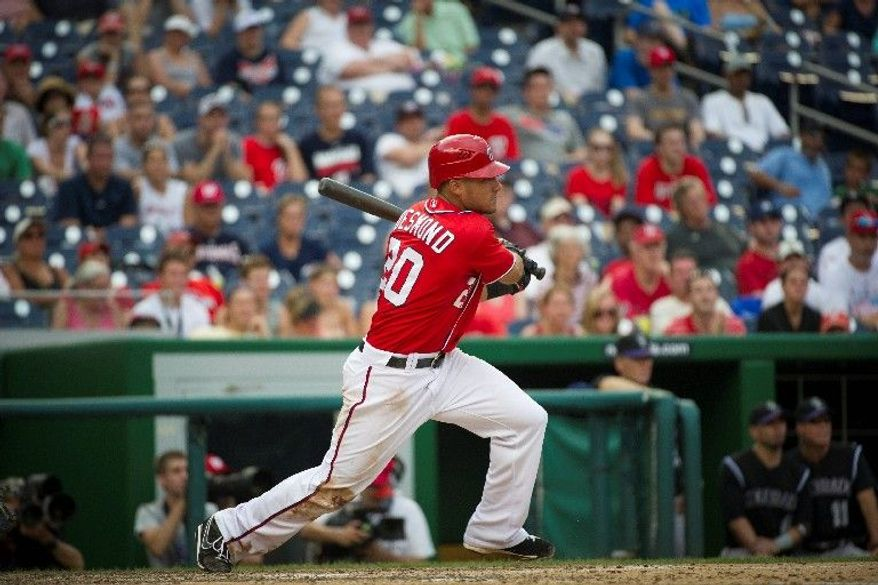 Washington Nationals shortstop Ian Desmond enters the All-Star break with a career-best 17 home runs, the most recent coming in Sunday's 4-3 loss to Colorado at Nationals Park. His previous best for homers in a season was 10 in 2010. (Rod Lamkey Jr./The Washington Times)