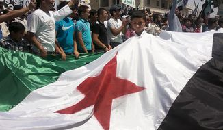 **FILE** This citizen journalism image provided by Shaam News Network and taken July 6, 2012, purports to show Syrians during a demonstration in Idlib, Syria. (Associated Press/Shaam News Network)