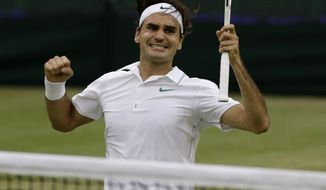 Roger Federer celebrates July 8, 2012, after winning the men's singles final against Andy Murray at Wimbledon. (Associated Press)