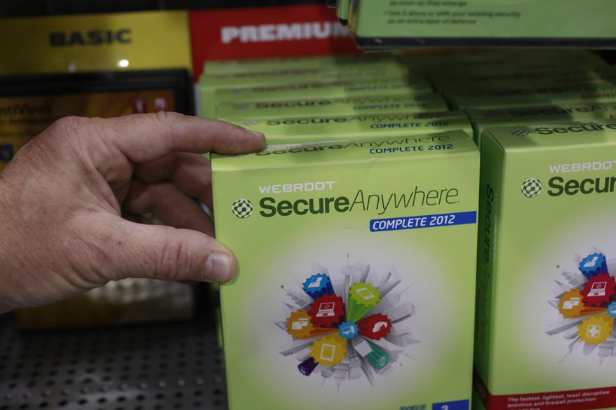 A customer holds Webroot's SecureAnywhere Complete 2012 software for computer security at Best Buy in Mountain View, Calif., on July 6, 2012. (Associated Press)
