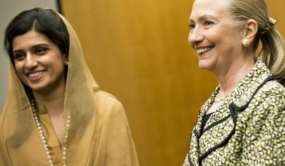 U.S. Secretary of State Hillary Rodham Clinton (right) and Pakistan Foreign Minister Hina Rabbani Khar poses July 8, 2012, before a bilateral meeting at a hotel in Tokyo. (Associated Press)