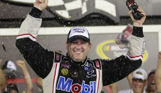 Tony Stewart celebrates after winning the NASCAR Sprint Cup Series race at Daytona International Speedway, Saturday, July 7, 2012, in Daytona Beach, Fla. (AP Photo/John Raoux)