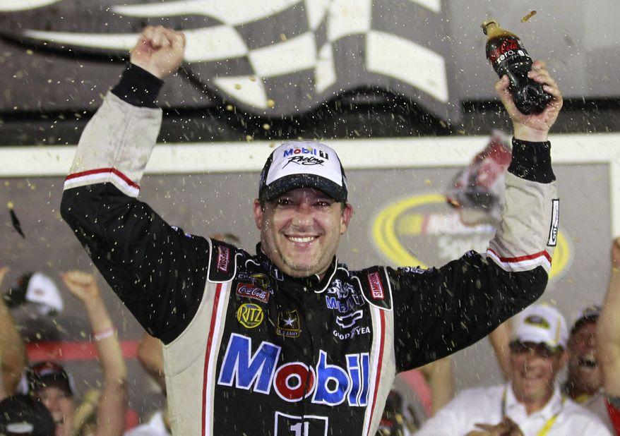 Tony Stewart celebrates after winning the NASCAR Sprint Cup Series race at Daytona International Speedway, Saturday, July 7, 2012, in Daytona Beach, Fla. (AP Photo/John Raoux)