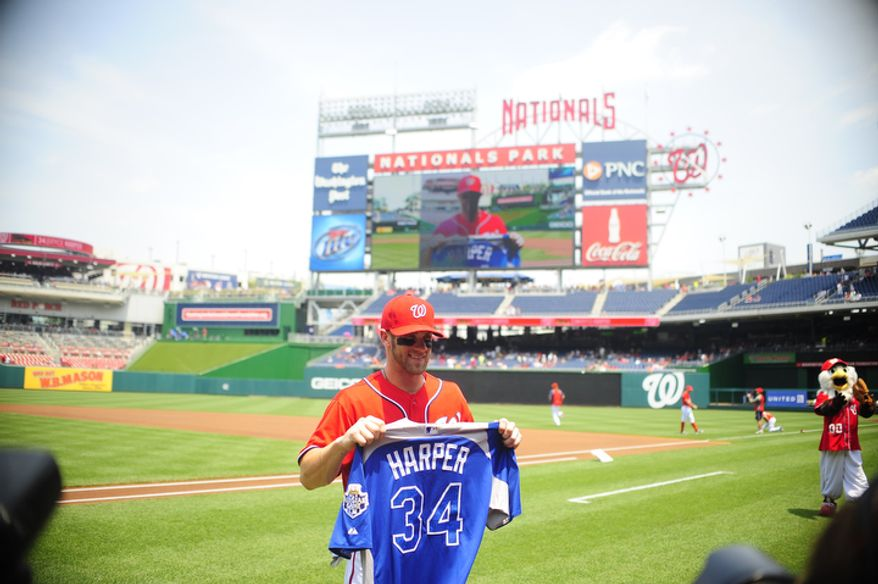 Bryce Harper holds his All Star game jersey prior to the start of the Nationals game against the Rockies.  (Ryan M.L. Young/The Washington Times)