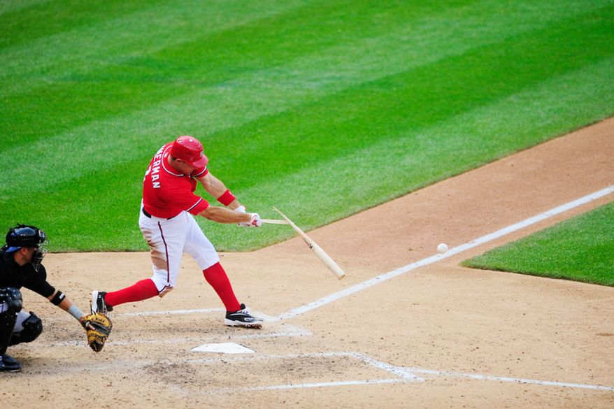 Ryan Zimmerman breaks his bat while hitting against the Colorado Rockies.  (Ryan M.L. Young/The Washington Times)