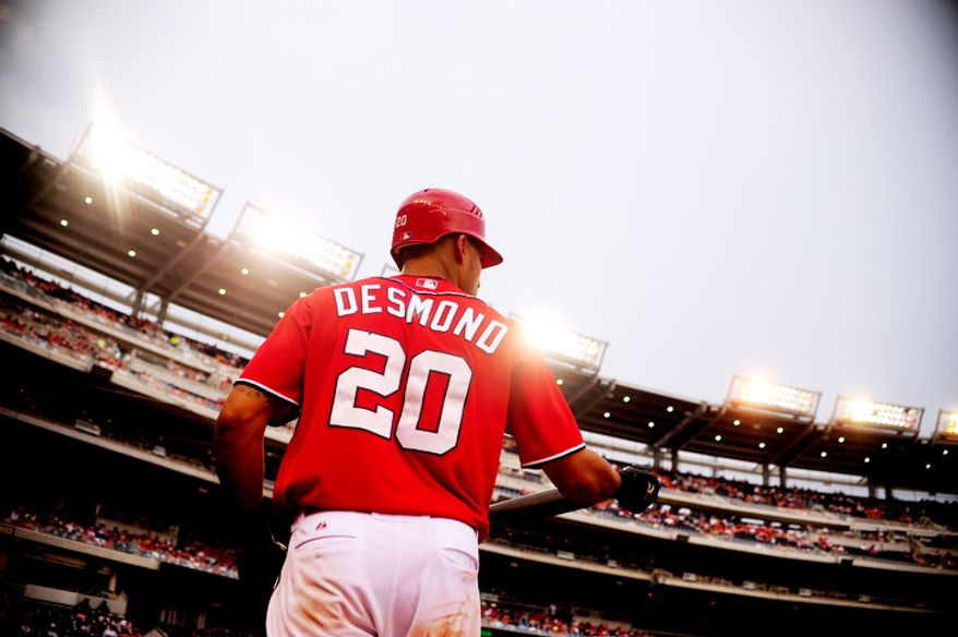 Ian Desmond waits in the on deck circle during the Nationals game against the Colorado Rockies.  (Ryan M.L. Young/The Washington Times)