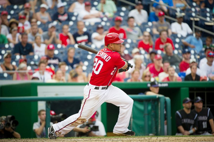 Nationals Ian Desmond singles in the bottom of the ninth inning as the Washington Nationals host the Colorado Rockies at Nationals Park in Washington, D.C., Sunday, July 8, 2012. The Rockies defeated the Nationals 4-3. (Rod Lamkey Jr./The Washington Times)