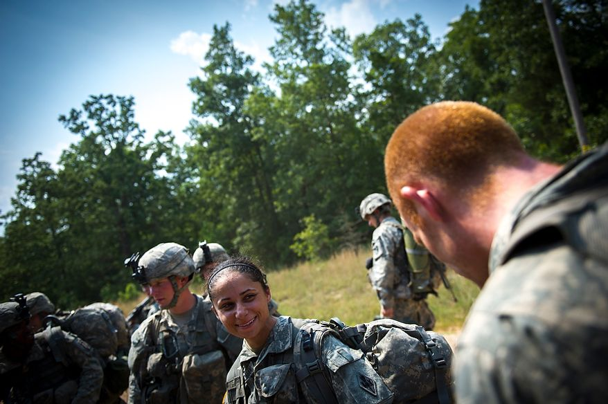 Sapper candidate and Army Captain Stephanie Godman (left) and the rest of the platoon board a waiting truck to be transported to a site for the next mission during another day of Sapper School training at U.S. Army Maneuver Support Center (MANSCEN) and Fort Leonard Wood in Fort Leonard Wood, Mo., Monday, June 25, 2012. (Rod Lamkey Jr./The Washington Times)