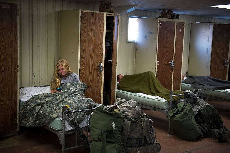 Sapper candidate and Army Captain Aston Armstrong wakes up after spending her first night in an actual bed after two grueling weeks in the field, a day after Sapper School training ended for the candidates at U.S. Army Maneuver Support Center (MANSCEN) and Fort Leonard Wood in Fort Leonard Wood, Mo., Thursday, June 28, 2012. (Rod Lamkey Jr./The Washington Times)