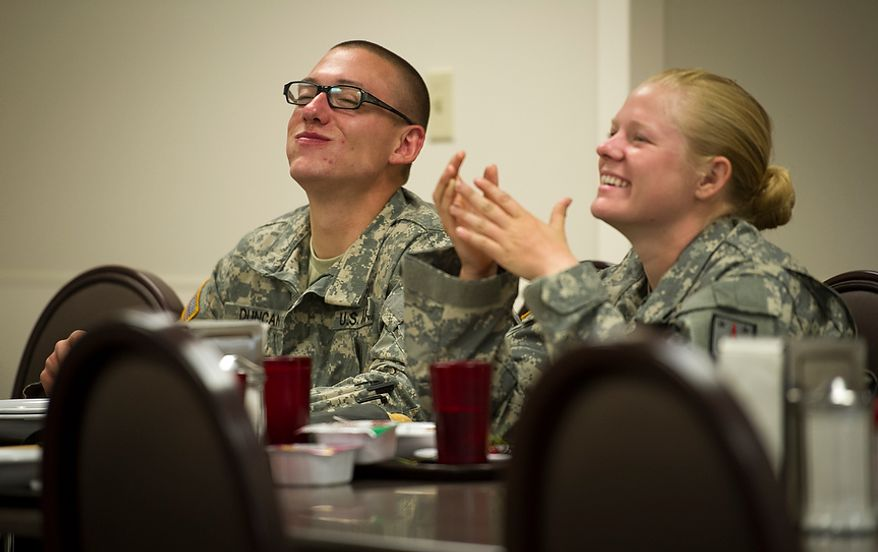 For her second fresh meal since training ended the day before, Sapper candidate and Army Captain Aston Armstrong joins some of the men in her platoon at the breakfast table after two grueling weeks in the field, a day after Sapper School training ended for the candidates at U.S. Army Maneuver Support Center (MANSCEN) and Fort Leonard Wood in Fort Leonard Wood, Mo., Thursday, June 28, 2012. (Rod Lamkey Jr./The Washington Times)