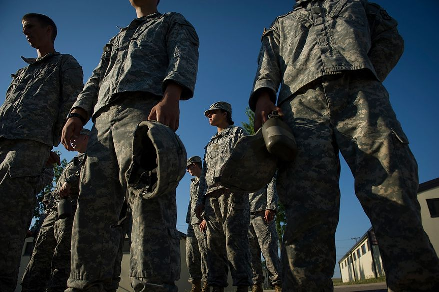 After taking care of medical details and missing breakfast with her platoon, Sapper candidate and Army Captain Stephanie Godman (second from right) joins them as they get their orders for the morning, day after Sapper School training ended for the candidates at U.S. Army Maneuver Support Center (MANSCEN) and Fort Leonard Wood in Fort Leonard Wood, Mo., Thursday, June 28, 2012. (Rod Lamkey Jr./The Washington Times)