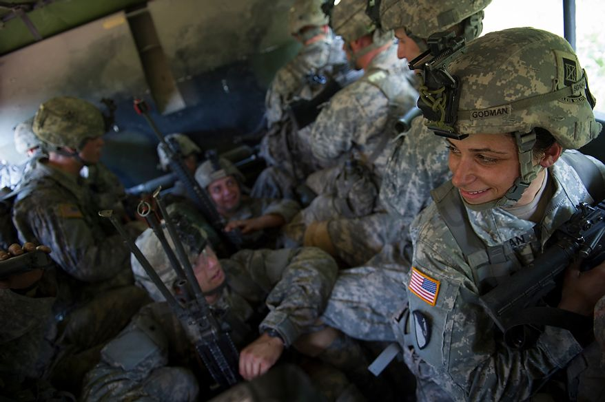 Sapper candidate and Army Captain Stephanie Godman sits in the sweltering heat with some members of the platoon aboard a truck to be transported to a site for the next mission during another day of Sapper School training at U.S. Army Maneuver Support Center (MANSCEN) and Fort Leonard Wood in Fort Leonard Wood, Mo., Monday, June 25, 2012. (Rod Lamkey Jr./The Washington Times)