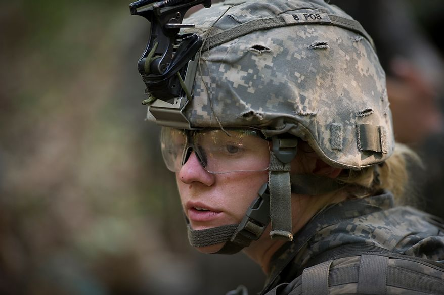 Taking the leadership role today, Sapper candidate and Army Captain Aston Armstrong prepares the position of her platoon for the next mission to detonate explosives, during another day of Sapper School training at U.S. Army Maneuver Support Center (MANSCEN) and Fort Leonard Wood in Fort Leonard Wood, Mo., Monday, June 25, 2012. (Rod Lamkey Jr./The Washington Times)