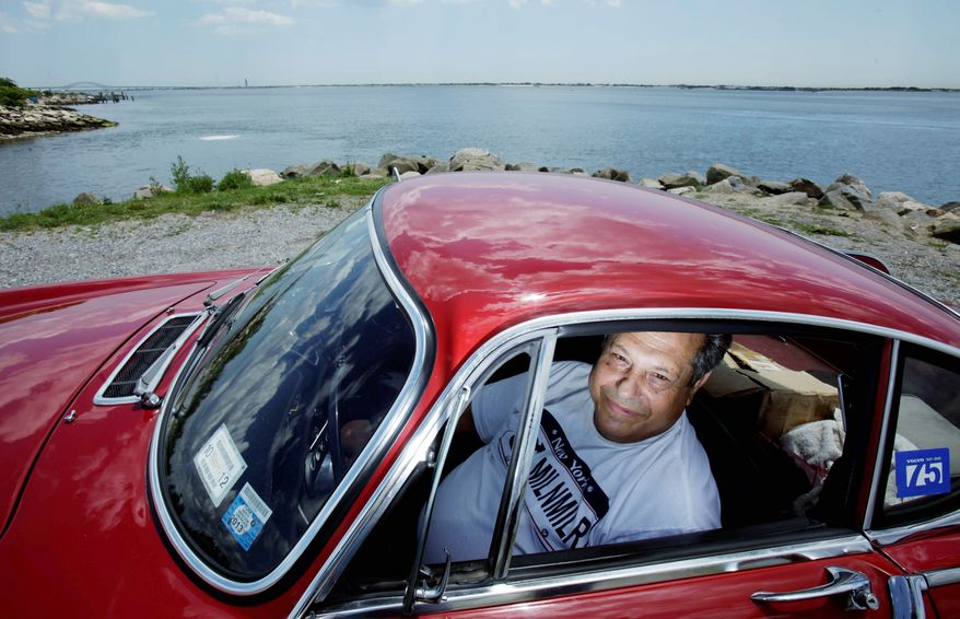 """Irv Gordon, from Long Island, N.Y., is only about 34,000 miles short of hitting the 3,000,000-mile mark behind the wheel of his Volvo P1800S. """"It's just a car I enjoy driving,"""" he explained. (Associated Press)"""