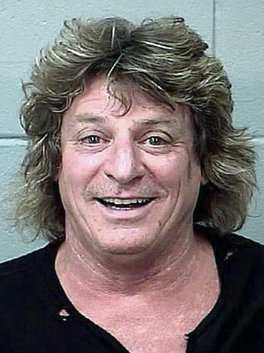 Mick Brown, drummer for classic rocker Ted Nugent, is charged with driving drunk in a golf cart stolen from a concert venue. (Bangor, Maine, Police Department)