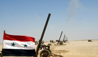 Syrian troops participate in a live fire exercise in an undisclosed location. (SANA photographs via Associated Press)
