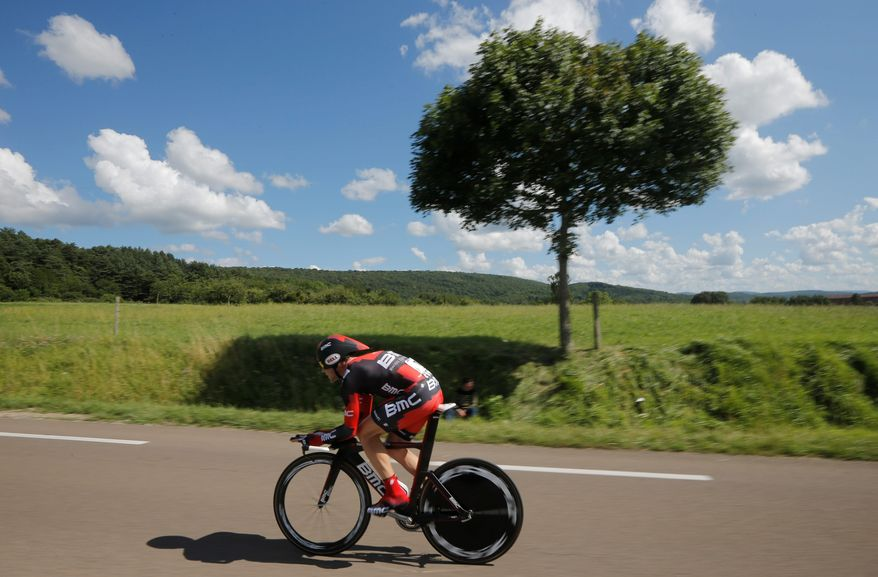 "Cadel Evans was sixth in Monday's Tour de France time trial. He is second overall, 1 minute, 53 seconds behind Bradley Wiggins. A day earlier, Evans called the time trial, ""the test of truth."" (Associated Press)"