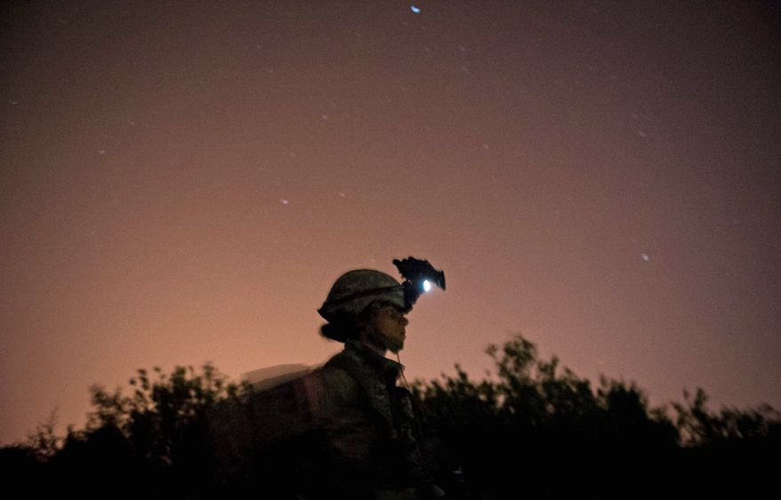 Army Capt. Stephanie Godman is silhouetted by a star-filled night sky after taking part in a night ambush exercise. Women have been allowed to go to the Army's sapper school since 1999. (Rod Lamkey Jr./The Washington Times)