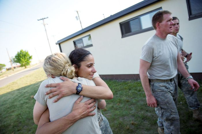 Army Capts. Aston Armstrong (left) and Stephanie Godman hug, cry and laugh after they made the cut at the conclusion of the grueling Sapper Leader Course. (Rod Lamkey Jr./The Washington Times)