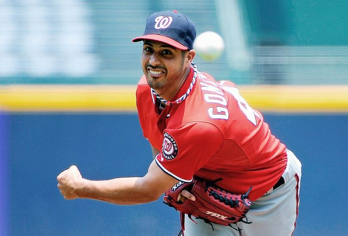 Washington Nationals starting pitcher Gio Gonzalez (47) throws to the Atlanta Braves in the first inning of their baseball game on Sunday, July 1, 2012, at Turner Field in Atlanta. (AP Photo/David Tulis)