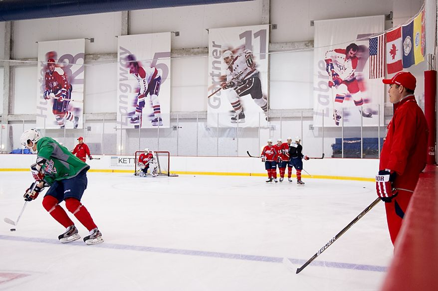 Washington Capitals head coach Adam Oates (right) watches the first day of practice at the annual development camp at the Kettler Capitals Iceplex in Arlington on Monday, July 9, 2012. (Andrew Harnik/The Washington Times)
