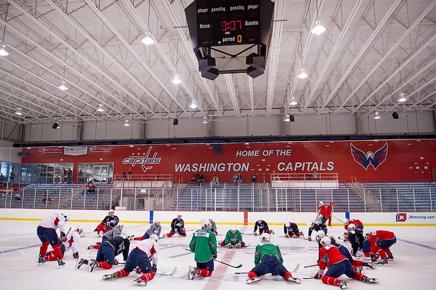 Players stretch together at center ice as the Washington Capitals have their first day of practice at the annual development camp held at Kettler Capitals Iceplex, Arlington, Va., Monday, July 9, 2012. (Andrew Harnik/The Washington Times)