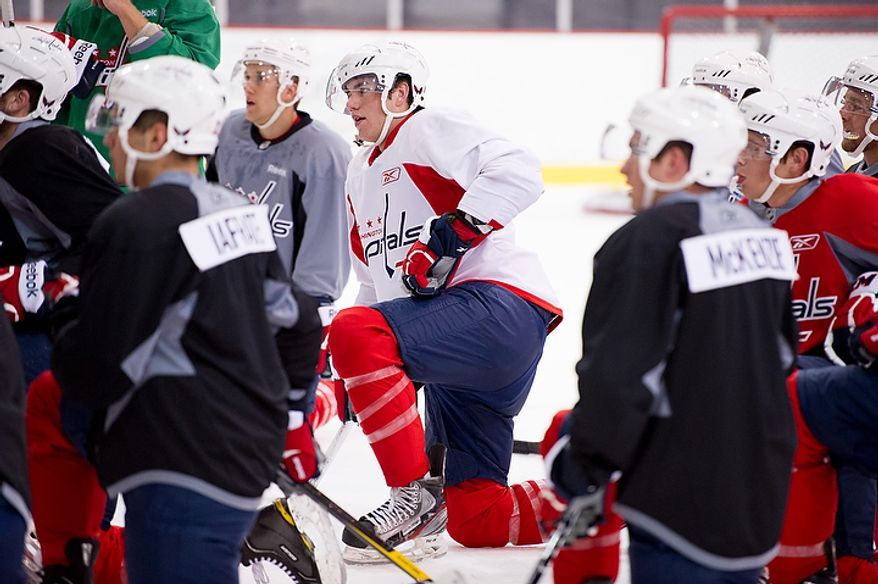 Tom Wilson (center) gets direction from coaches during practice with the Washington Capitals on their first day of practice at their annual development camp at the Kettler Capitals Iceplex in Arlington on Monday, July 9, 2012. (Andrew Harnik/The Washington Times)